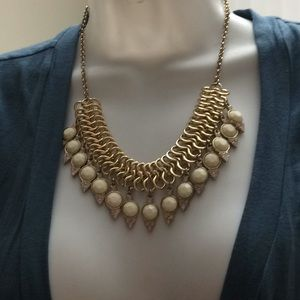 Gold tone tiered necklace